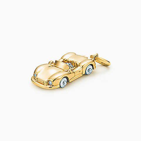 Berloque de carro esportivo com diamantes em ouro 18k.