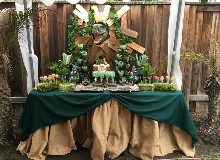 Dinosaur Party candy bar set up with awesome Dino display.