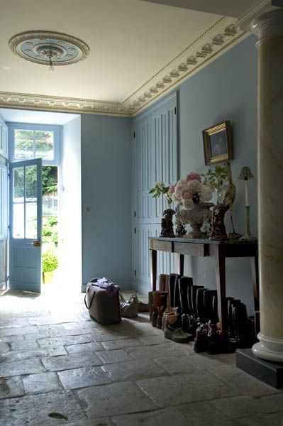 Nice long entry for a large country cottage. Restful shade of blue on the walls and a well worn stone set floor