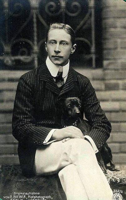 Kronprinz Wilhelm von Preussen, Crown Prince Wilhelm of Prussia, son of Kaiser Wilhelm II, with a small dog