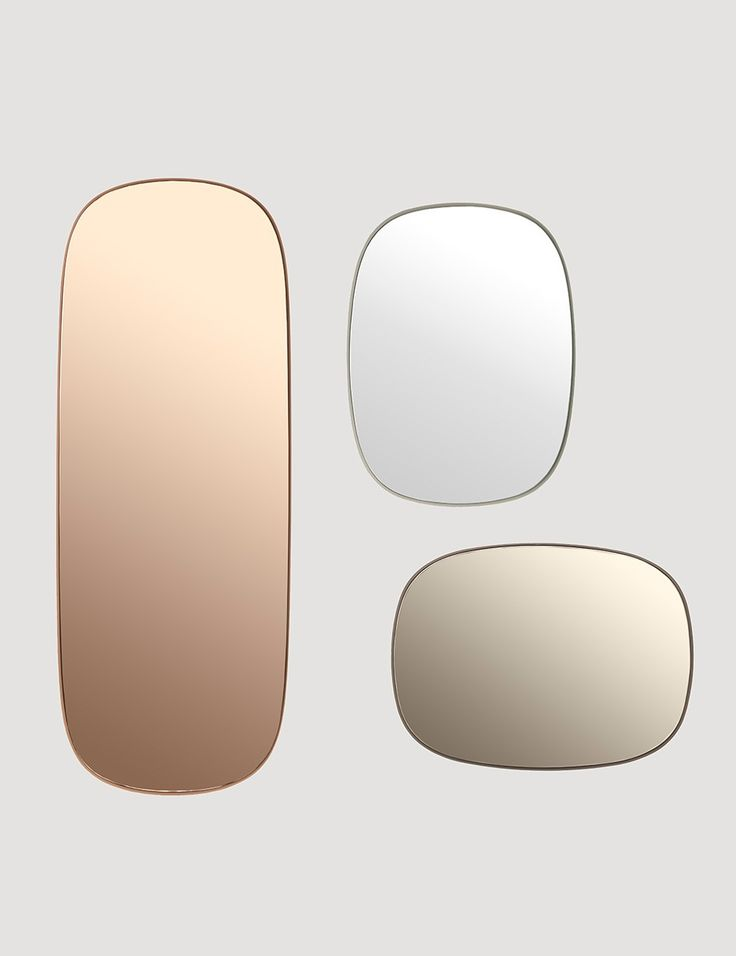 A series of mirrors in two sizes and three color versions. Mirrors with colored glass that challenges the function of a classic mirror and adds the dimension of decoration to an interior setting. Hang the mirrors in groups of two or more to create an almost art-like mirror installation on a wall. The mirrors are suited for use in bathrooms and other wet rooms.
