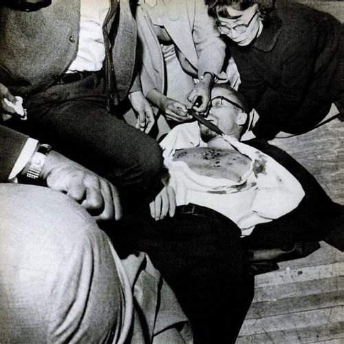 Human rights activist Yuri Kochiyama cushions the head of civil rights leader Malcolm X on the floor of the Audubon Ballroom after he was shot by an assassin, Harlem, New York, United States, 1965, photograph by LIFE (photographer unattributed). Kochiyama, interned with tens of thousands of other innocent Japanese-Americans during World War II, was a California native who was vocal in her support of equality and human dignity for all peoples. She died in June of 2014 at age 93.