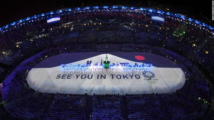 During the closing ceremony on Sunday, August 21, a projection of the rising sun…
