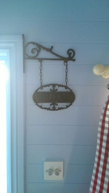 Boys playhouse, ranch style.. welcome sign that should be outside but it worked better inside..