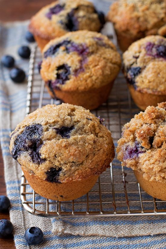 These sky-high whole wheat blueberry muffins are moist, tender and bursting with sweet blueberries. They're they perfect way to start your day!