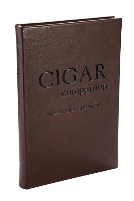 GIFTS FOR THE GUYS: THE BOOK  A luxe leatherbound book on the history of cigars, complete with etiquette and expert buying advice.     Cigar Companion Book