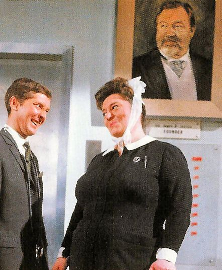 Kenneth Williams & Hattie Jacques, with James Robertson Justice looking down on them in Carry On Doctor