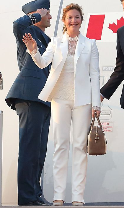 Sophie arrived at Hanaeda Airport in Japan with her husband, Prime Minister Justin Trudeau, wearing a white suit with lacy camisole by Marie Saint Pierre and toting a Want Les Essentials bag. Both brands are based in Quebec.<br><p>Photo: © Getty Images</p>