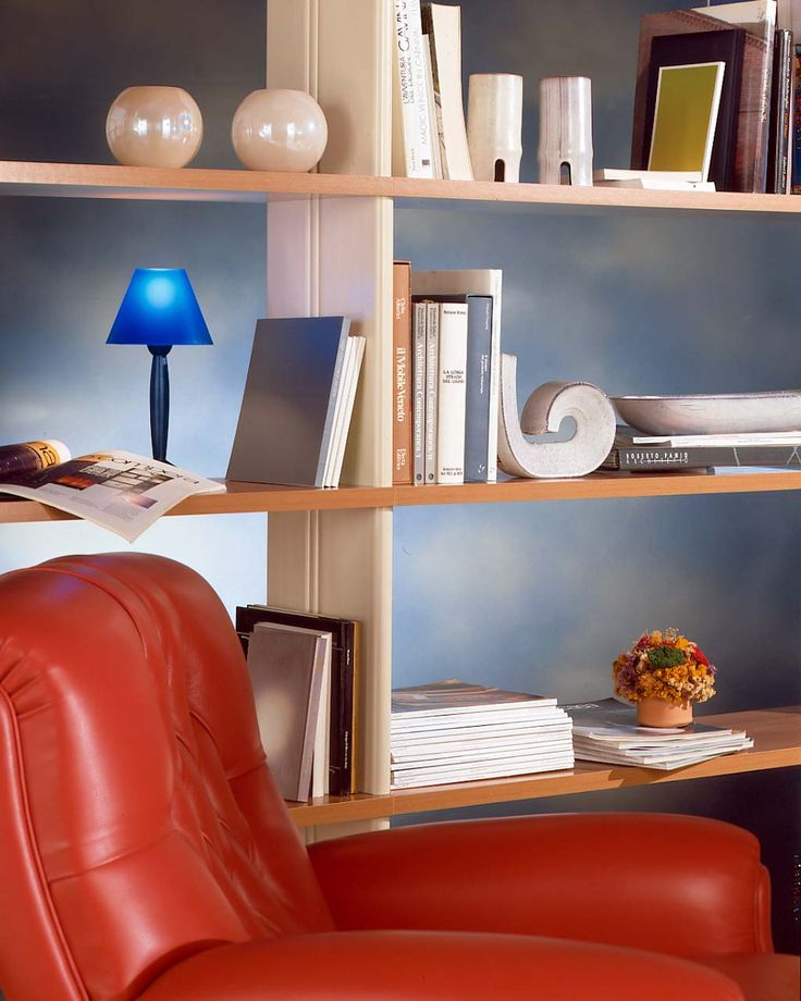 Nikka bookcase near a classic red armchair