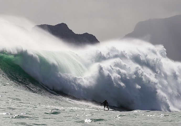 Cape Town, South Africa: Surfer Mike Schlebach rides a wave at an offshore reef
