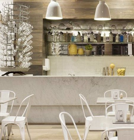 Great textures marble timber tile + metal chairs at The Capital Kitchen, Melbourne