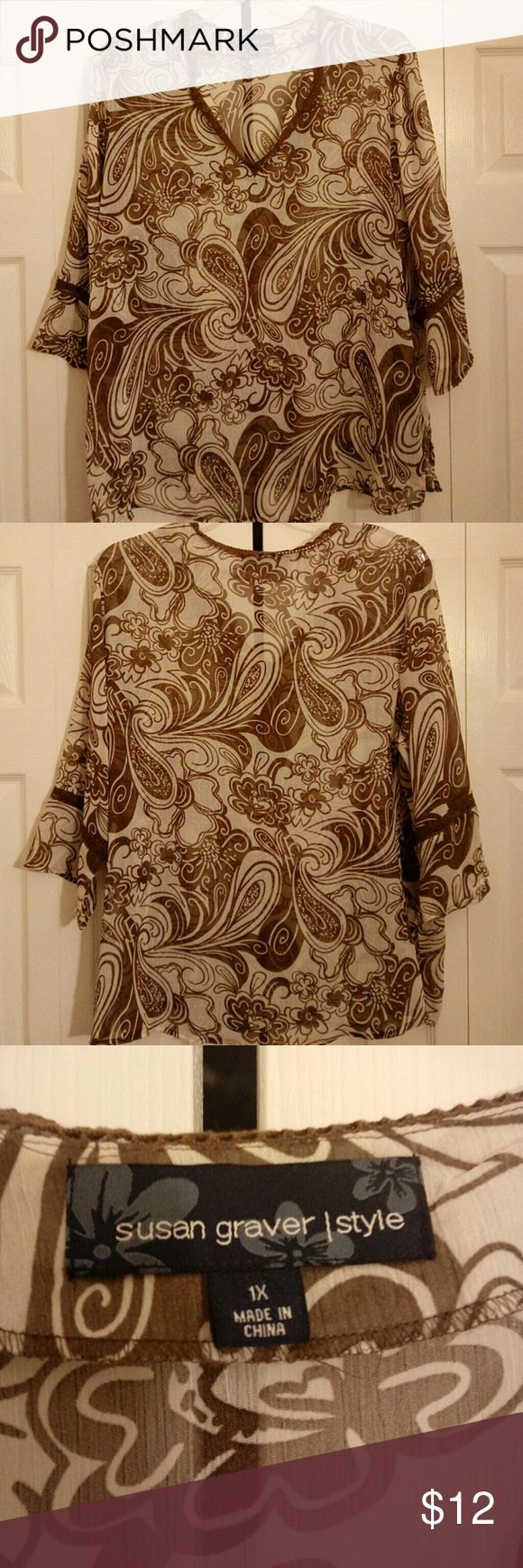 SUSAN GRAVER/Style/Top This top have flowers and graphic design the material is sheer and very soft it's100%  polyester,machine wash cold water gentle cycle and line dry it also have slit on bottom of each sleeve and slits on each side Susan Graver Tops