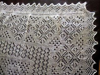 one corner of an Orenburg shawl. Orenburg is a city in Russia, where these were traditionally made. There are many, many patterns for Orenburg shawls -- it's a type of knitted lace.