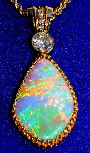"""Transfixing Opal & Diamond Pendant surrounded by Gold to enhance the Orange, Green & Blue broad flashes of this """"enlightened"""" Opal"""