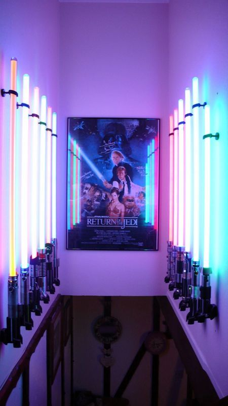 "AWESOME.  12 lightsabers and what appears to be an autographed ""Return of the Jedi"" poster..."