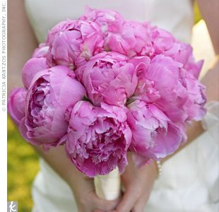 A bouquet with bright, pink and full peonies.