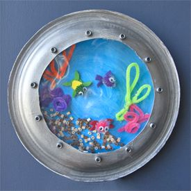 Decorate your space for some creative play when creating a colorful underwater porthole using paper plates!