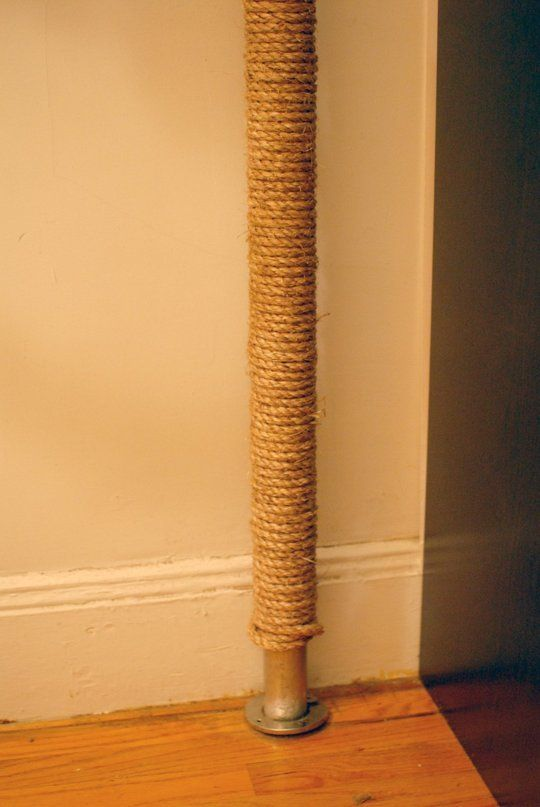 Wrap radiator pipes in cord and get rid of tattered cat scratcher. Every square inch counts in our LR!