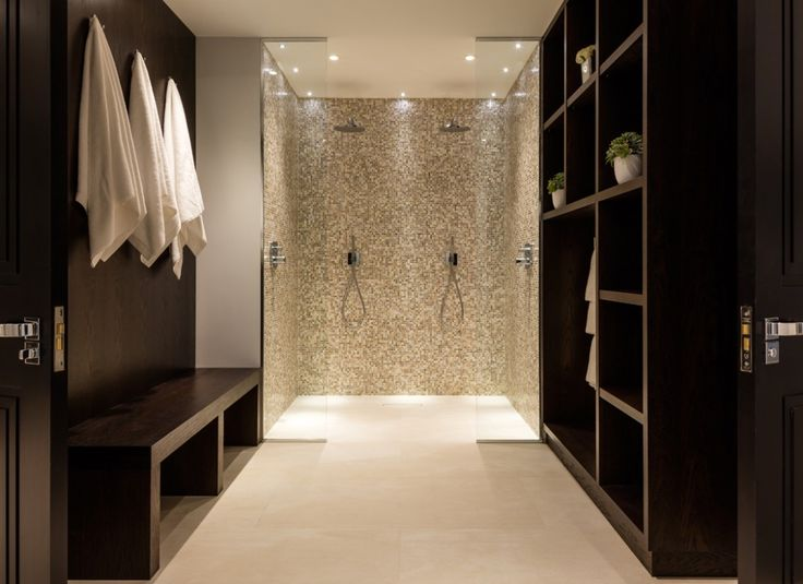 Mini LED ceiling downlights create a feature of the his and hers shower cubicle in the changing room to this luxury pool suite.