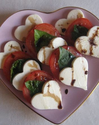 Use heart cookie cutters to make heart shaped mozzarella cheese then then pair them with sliced tomatoes, basil leaves, & drizzled balsamic!
