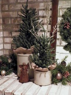 Everything In Between by Kelly & Tiffany: Rustic Christmas Mantel. Use brown, green, and old crocks.