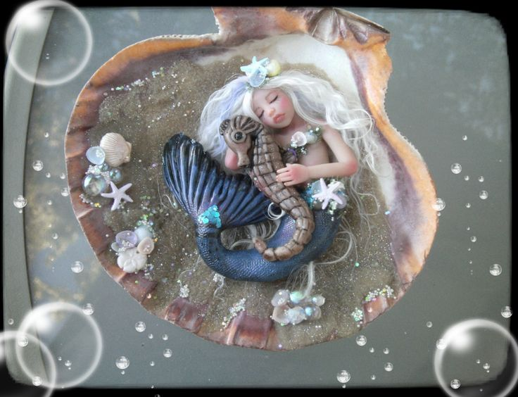Friends a OOAK (One of a Kind) Mermaid and seahorse friend sculpted in Polymer clay and finished in mixed media.