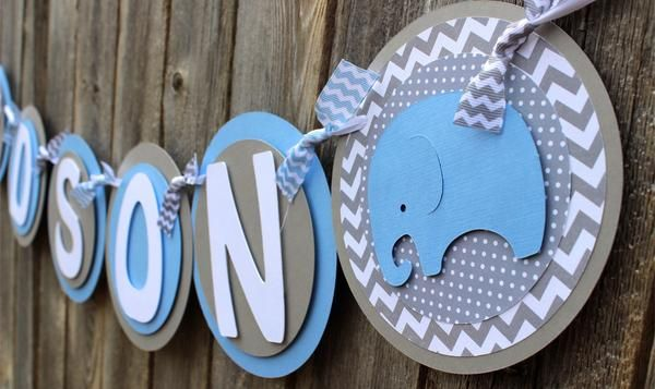 This is a super adorable elephant baby shower banner! Each pennant measures 5.75 inches and are layered with cardstock and paper stock. Coordinating ribbon adds