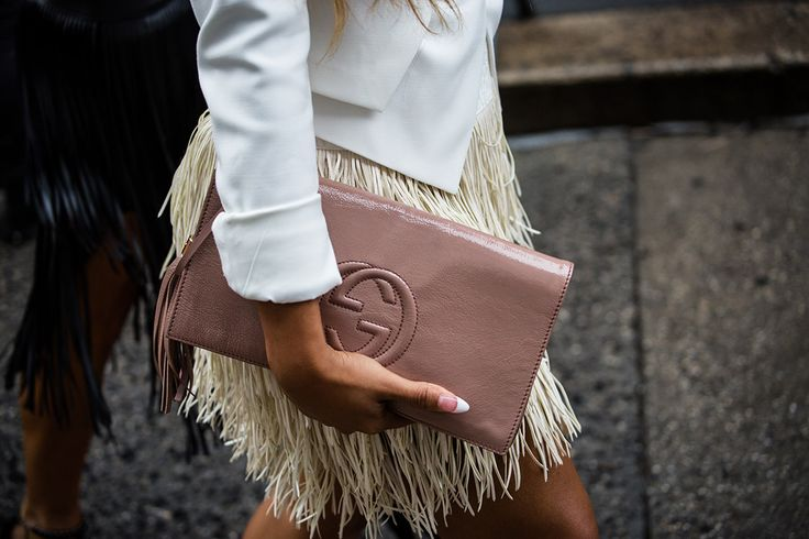 SS16 streetstyle detail  Gucci clutch  white jacket  tufted fringe skirt