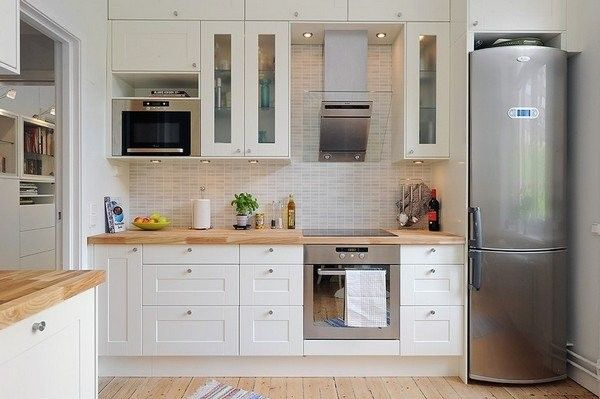 I don't know if I like white kitchens because I grew up with them, or if they are just really cool.  I'm thinking I'm leaning toward wood finish though to better hide fingerprints. No to wood countertop although it looks good.
