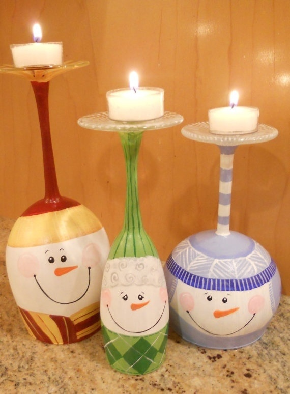 Snowmen painted on wine goblets and then used as candleholders. Adorable!