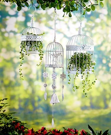 Vintage-Inspired Garden Decor adds a more sophisticated country look to your yard. Each is designed like a birdcage with an intentionally distressed finish. The