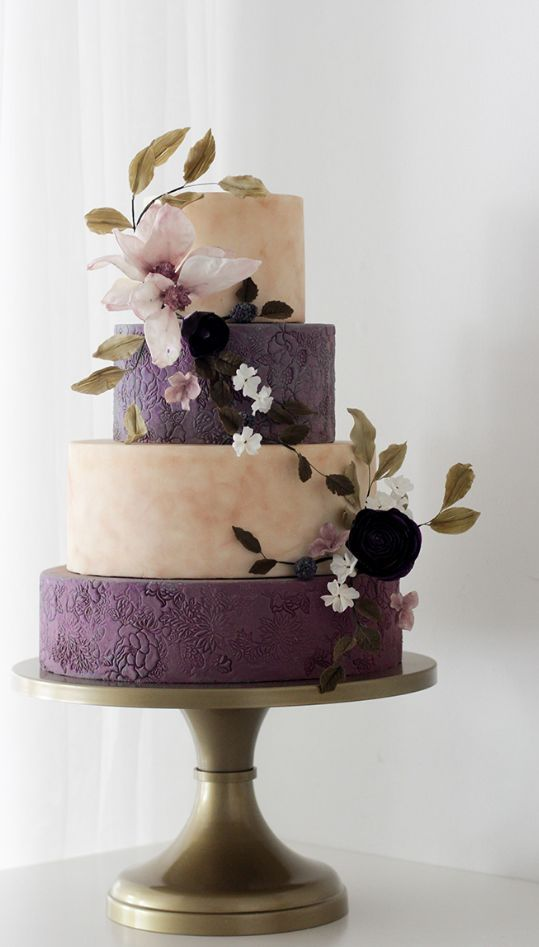 Rustic chic purple and white wedding cake accented with a breathtaking floral design; Featured Cake: Winifred Kristé Cake