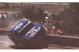 The Rock - This is arguably the most talked about incident in Bathurst history. It propelled the then relatively unknown Dick Johnson into the national spotlight when, while talking live on national television, he broke down as he recalled the incident.    You can see from the image how perilously close the track marshalls came to serious injury. Also see: 1980 Bathurst Race Program