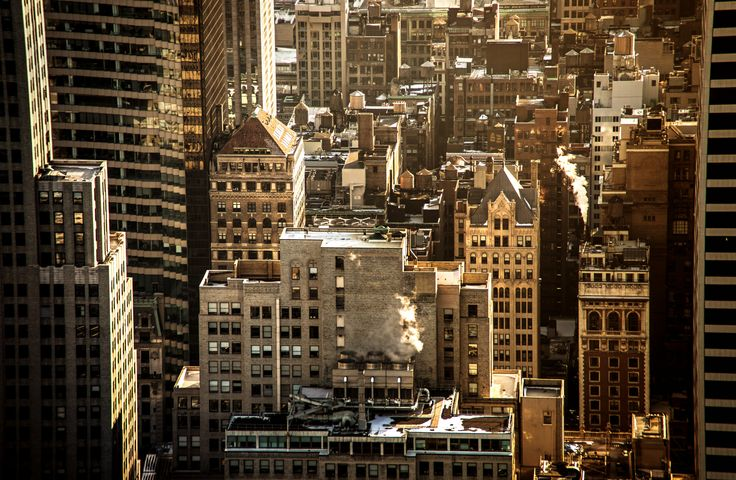https://flic.kr/p/dRqNaU | New York City Rooftops - Midtown Skyscrapers | These are the skyscrapers of midtown Manhattan from above as seen from the top of Rockefeller Center (Top of the Rock). Looking out over these time and weather-worn buildings, it's almost incredible to think of the sheer amount of activity occurring behind each tiny-eyed window at any given time.  This is a scene that peaks in the teasing warmth of winter sunlight as the sun dips towards the horizon in the late…