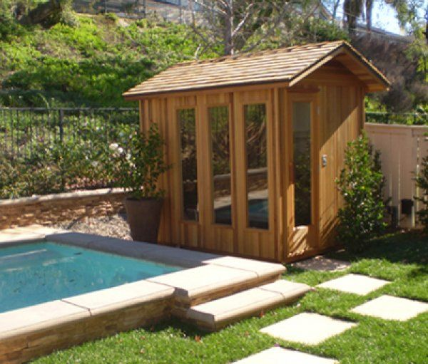 Here's a cool poolside outdoor sauna with vertical glass windows.