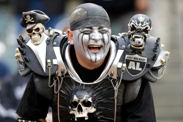 An Oakland Raiders fan smiles during an NFL preseason football game between the Oakland Raiders and the Dallas Cowboys in Oakland, Calif., Friday, Aug. 9, 2013. (AP Photo/Ben Margot) Photo: Ben Margot, Associated Press