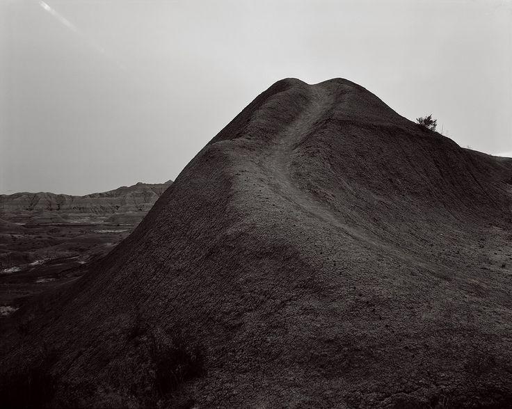 Badland Moonset, Badlands National Park, South Dakota © David Shannon-Lier, 1st place, series, LensCulture Exposure Awards 2015. Of Heaven and Earth - Photographs by David Shannon-Lier | LensCulture