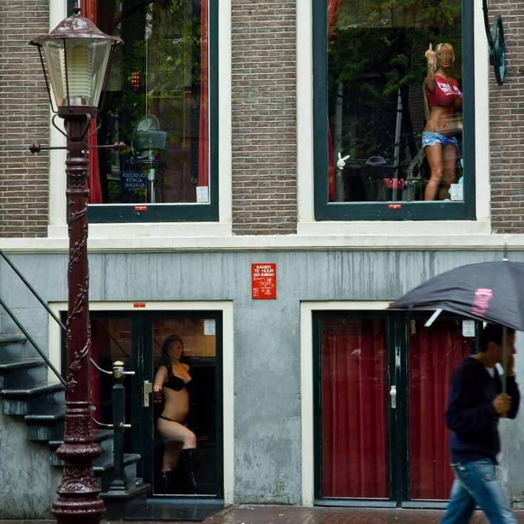 Red Light District Amsterdam  Holland  The companions stay on shop windows the customer chooses and solves the problem right there they just close a curtain and bang... When you are photographing in the street especially in places where it is not allowed there are times where it is possible to argue in others the best strategy is to run. The lady didn't liked very much that I was photographing her so after registering the moment I ran a lot if the security catches me I would be very screwed…
