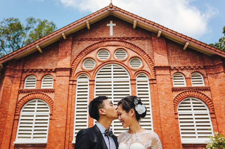 Kiss on forehead, in front of the church. Photography by Jonah Sun, principal photographer of All Aflutter