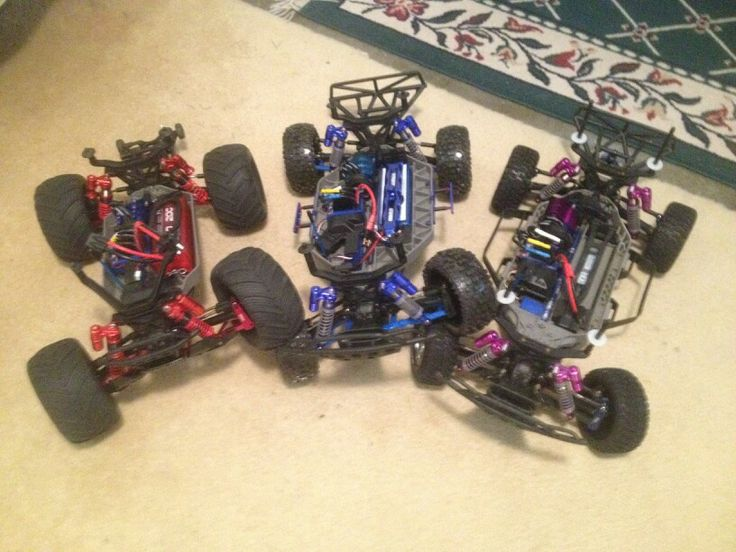 Traxxas....4x4 Stampede. 4x4 Slash. 4x4 Slash with low center of gravity chassis and suspension. Stampede has been modified with all aluminum parts. Extended length dual chamber shocks. Center Slsh has all lightweight rpm blue parts. Also extended length dual-chamber shocks. Slash on the right has dual chamber shocks low center of gravity chassis and is geared for speed.