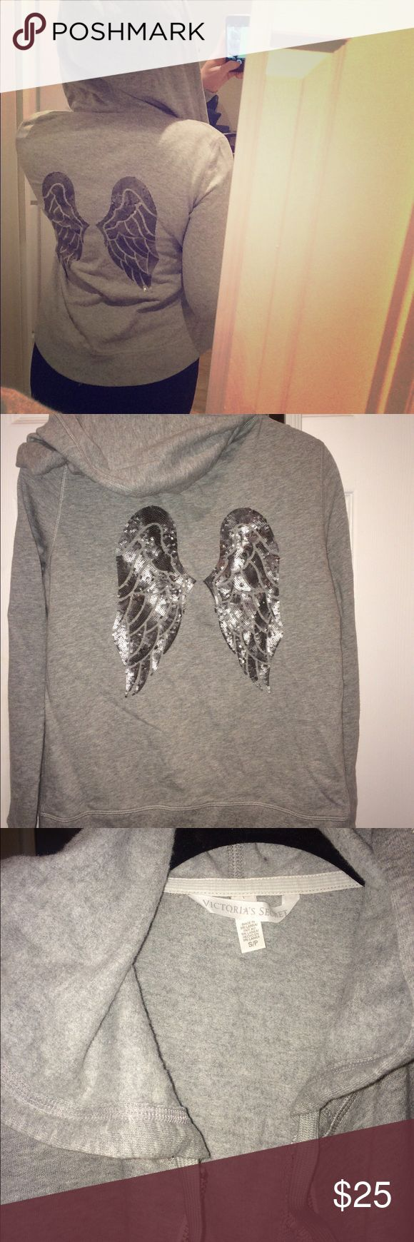 VS Grey zip up hoodie Never worn grey zip up hooded sweatshirt from VS. Fitted, moderately warm, and so cozy. Well-made and all sequins on the wing design are in tact. Victoria's Secret Tops Sweatshirts & Hoodies