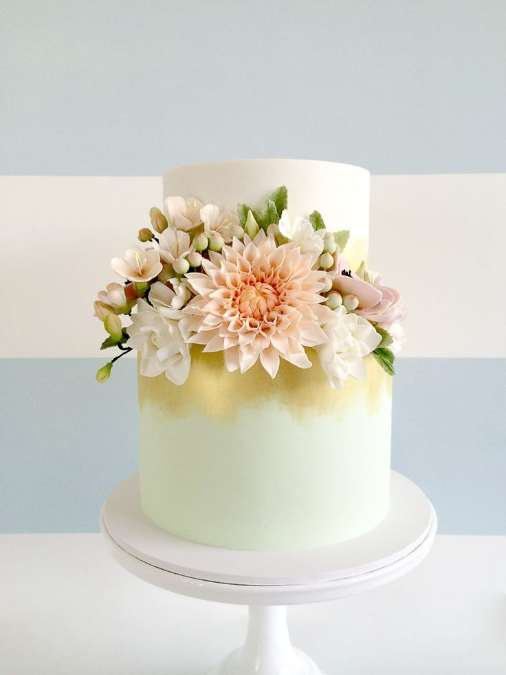 two tiered mint wedding cake with sugar flowers