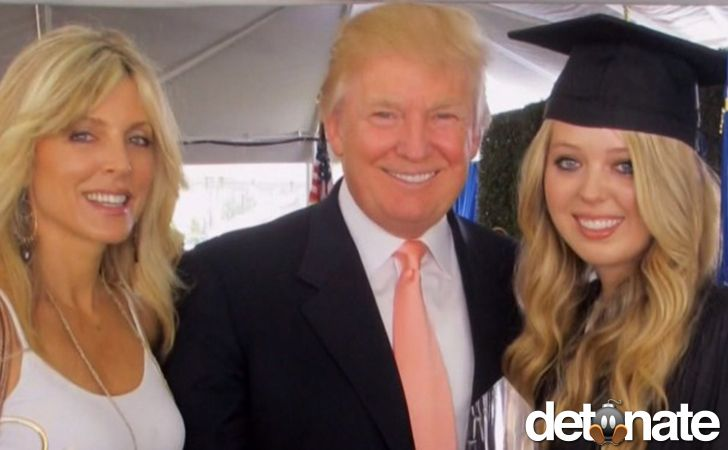 Proud parents, Marla and Donald, pose with their daughter, Tiffany, at her graduation.