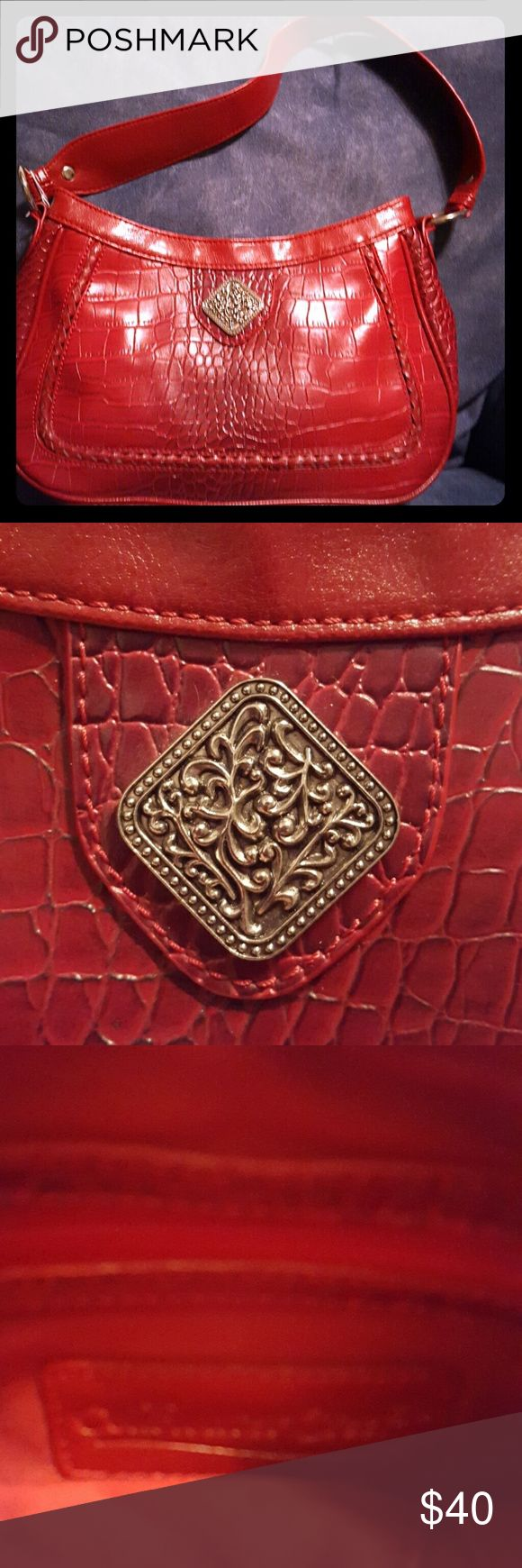 Red Coldwater Creek bag.  NWOT Beautiful red bag! Coldwater Creek beautiful leather with a designer metal piece that makes it beautiful and indicates that this bag is a Coldwater Creek bag. NEW! Coldwater Creek Bags Shoulder Bags