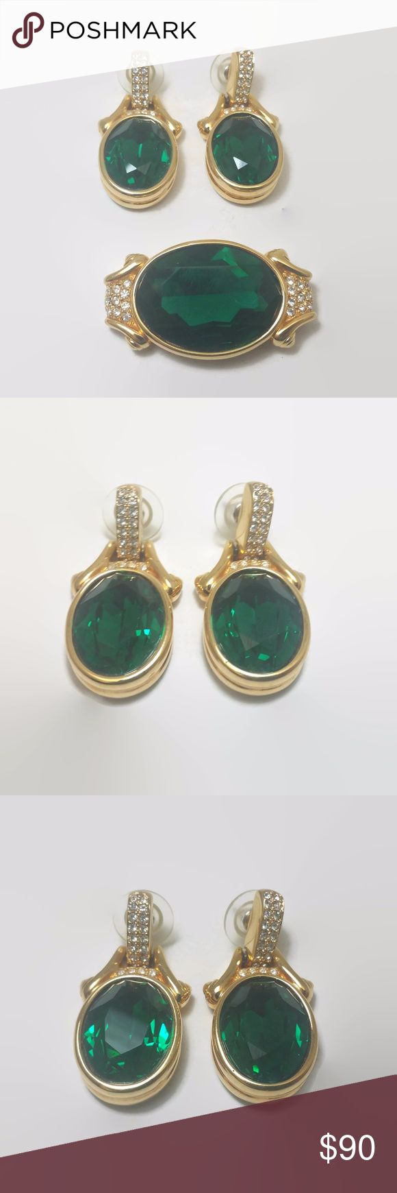 """Swarovski Gold Tone Green Crystal Pin & Earrings This is an absolutely gorgeous signed Swarovski (swan logo) gold tone pin and earrings set.  Each are set with a faceted emerald green color crystal flanked by smaller, sparkling clear stones.  The earrings measure 1.5""""l. x .75""""w. and are for pierced ears.  The brooch measures 1""""l. x 1.75""""w. Swarovski Jewelry Earrings"""
