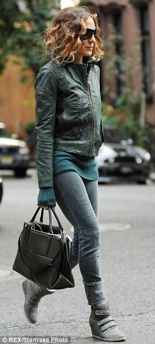 What an influence: The fashion savvy mom wore different shades of green in her jeans, jumper and jacket, as well as her chic wedge trainers ...