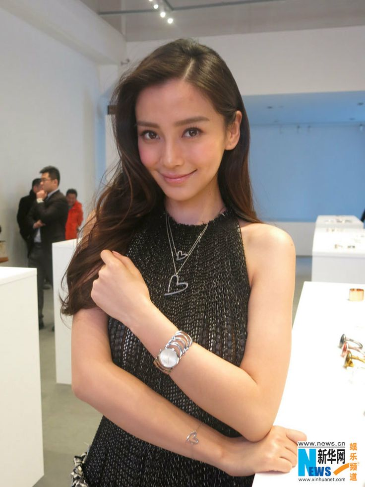 Hong Kong actress and model Angelababy made her first public appearance at a promotional event for Calvin Klein watches in Shanghai, China, March 11, 2014 after announcing her love with Chinese actor boyfriend Huang Xiaoming