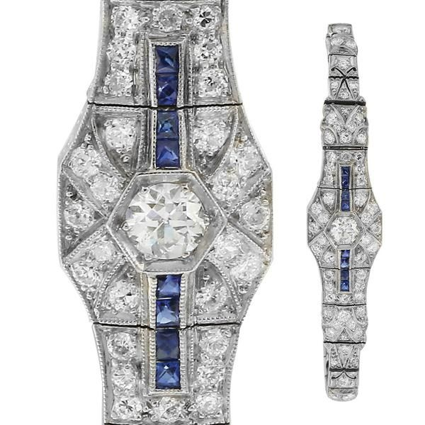 Art Deco sapphire and diamond articulated, square panelled, platinum bracelet. The diamonds are mille grained and bead set with the centre diamond in a raised hexagonal beaded setting. The bracelet side panels are hand engraved. There is a safety chain attached. This piece is Circa 1930.