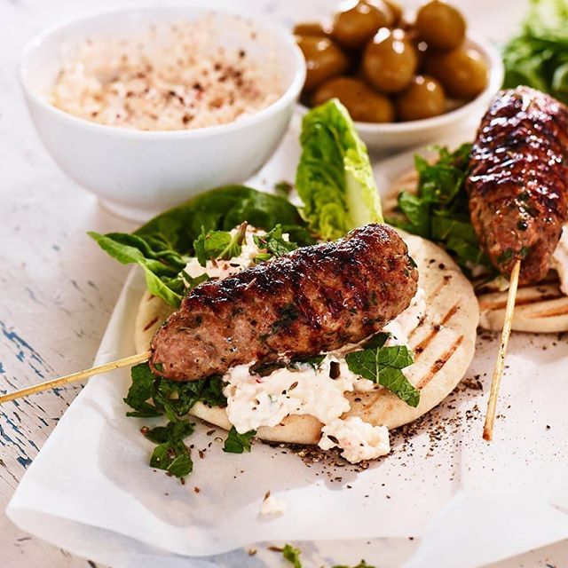 We wouldn't mind having these spiced lamb kebabs with a creamy white cheese dip and grilled pita for lunch today. Would you? Just 20 minutes prep time. Find the recipe on our website #lamb #summermeal #spicy #lunch #dinner #cheesedip