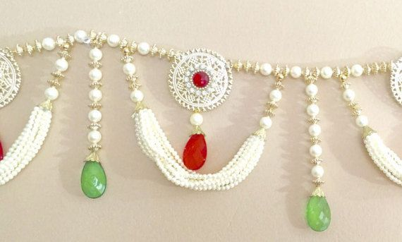 Diwali, Special Occasion Toran!!!  Feel the Aura Of Indian Festivals with this Toran- Door Hanging or wall decor.  The Toran is symbolic Welcome of God and guests on the door! Its a perfect home décor for different festivals, weddings and special occasions. Made of different sizes of pearls and other beads.  On Diwali, Welcome Shree Lakshmi and guests with this beautifull door hanging!   Can be used daily at doors or Pooja ghar.  Size: 36 inches